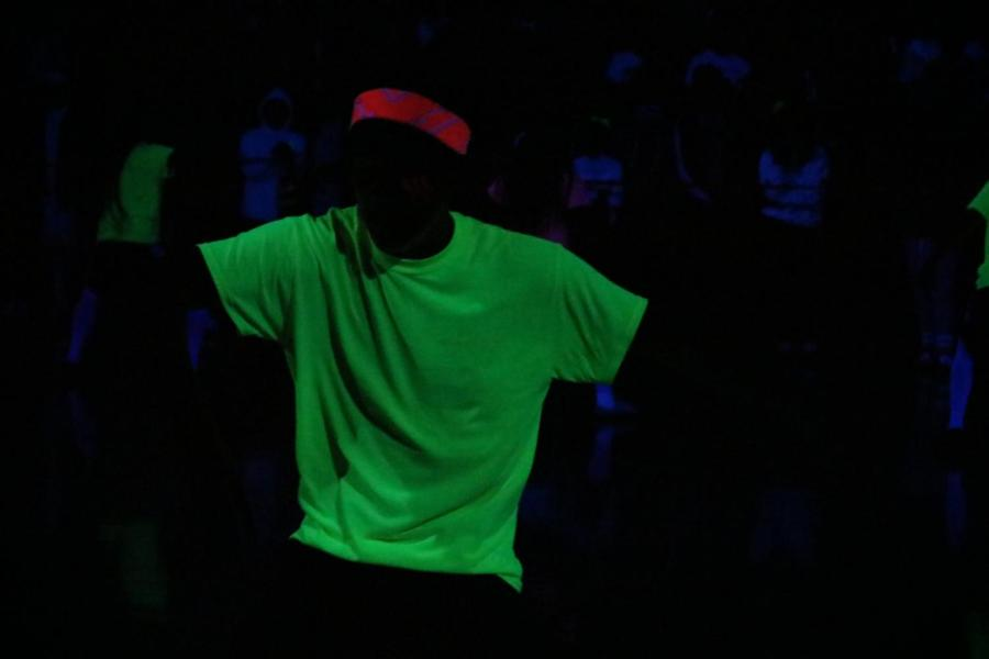 Students+wore+white+and+neon+colors+during+the+rally+to+reflect+in+the+blacklight.+