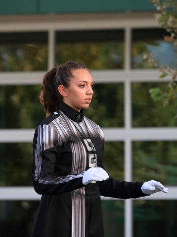 Drum major Shani Zuniga doesn't only conduct