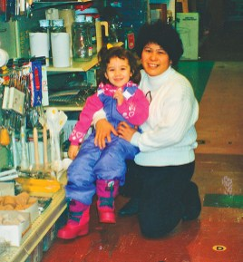 Socorro with goddaughter Vida Nelson at Nelson's Hardware Store, 1988. (Socorro Alfonso Collection)