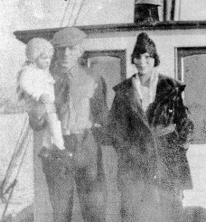Teslin, Carl and baby Buster on the family boat in Seattle, ca 1921. (Carol Young Family Collection)