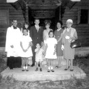 Phillpotts family with couple married by Joshua in front of church in Watson Lake. Front row, l to r: Joshua, Kathleen, Andrew, Margaret, Joshua's mother Lena: back row: unidentified person, new husband and bride, Yvonne. (Phillpotts Family Collection)