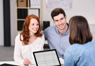 Couple Younger With Female Insurance Agent.jpg