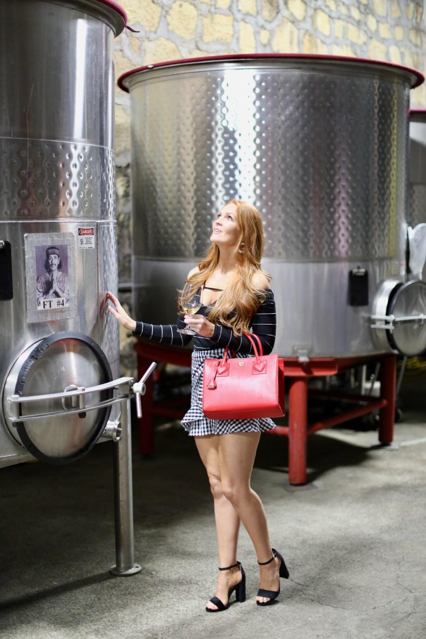 fashion blogger exploring the wine making process at testarossa winery in Los Gatos