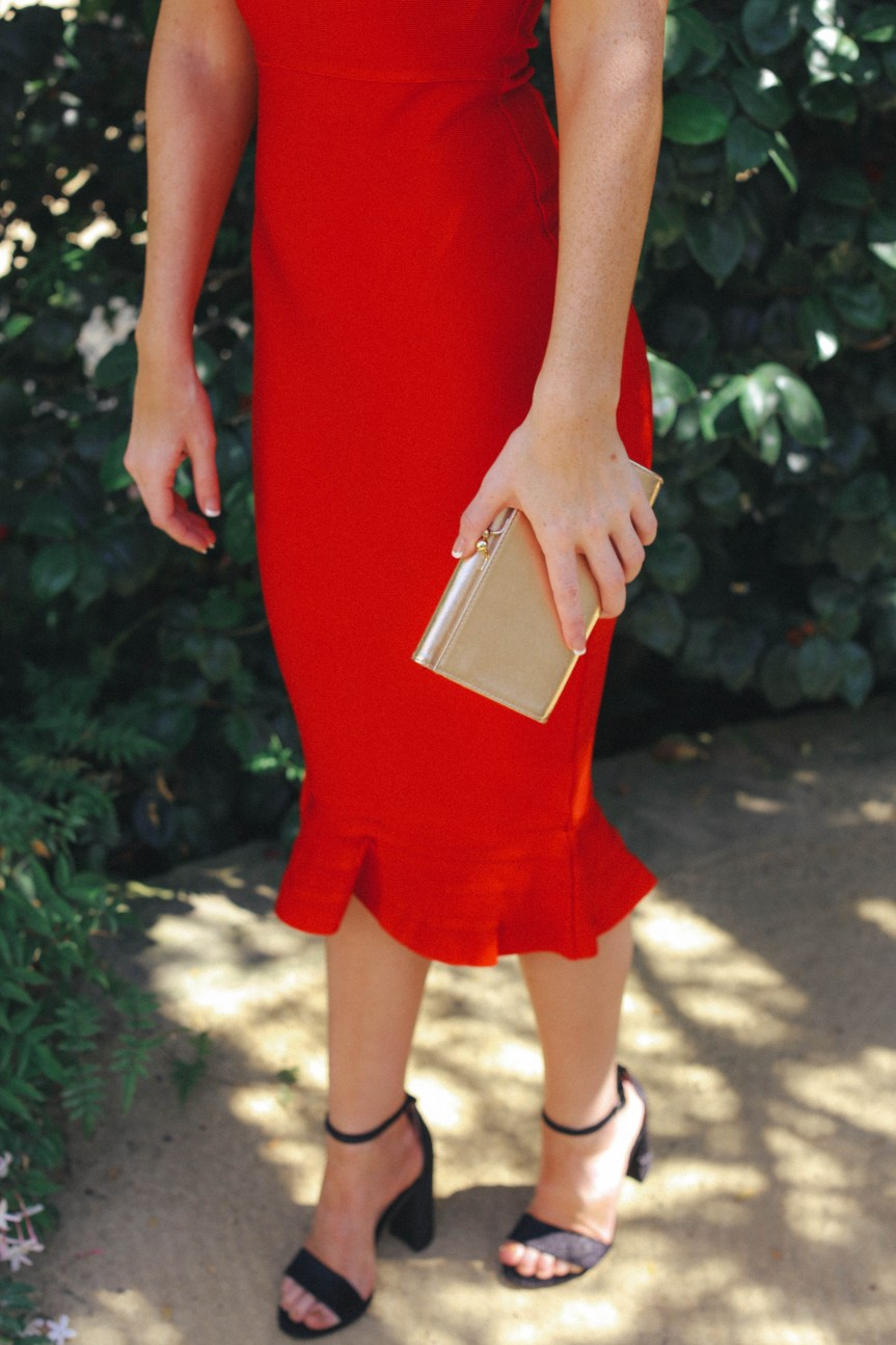 Red dress with simple accessories that make this outfit chic
