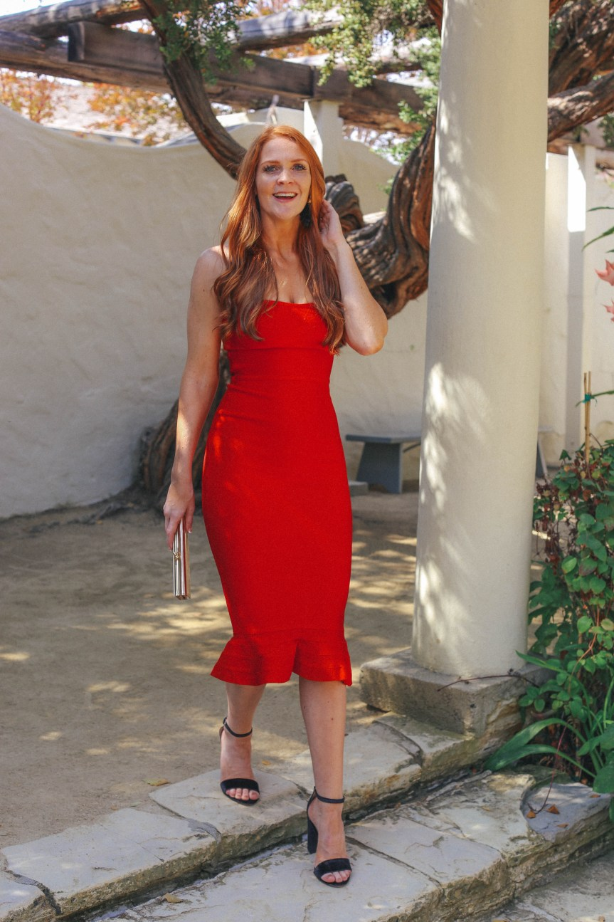 fashion blogger shared sexy red holiday dress