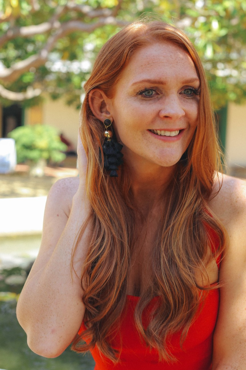 Bold red dress with black earrings, fashion blogger