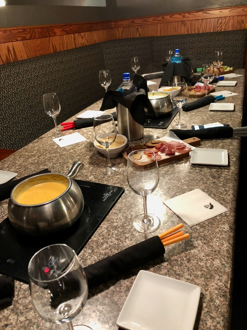 The melting pot table featuring their cheese founde