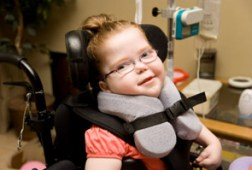 Young girl using wheelchair