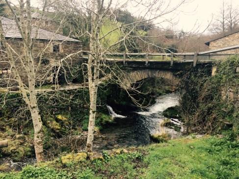 Old bridge over a river in Santa Eufemia, Asturias, north of Spain.