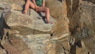 Big Slut Masturbating On The Rocks Caught With An Outdoor Hidden Camera