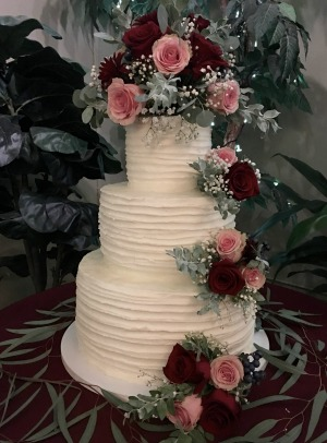 white wedding cake with flowers in utah