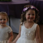two sweet little girls at wedding reception