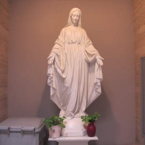 "A statue of a ""Miraculous Mary"" located in the main lobby of St. Albert hall. Created by St. John's University, Office of University Mission."
