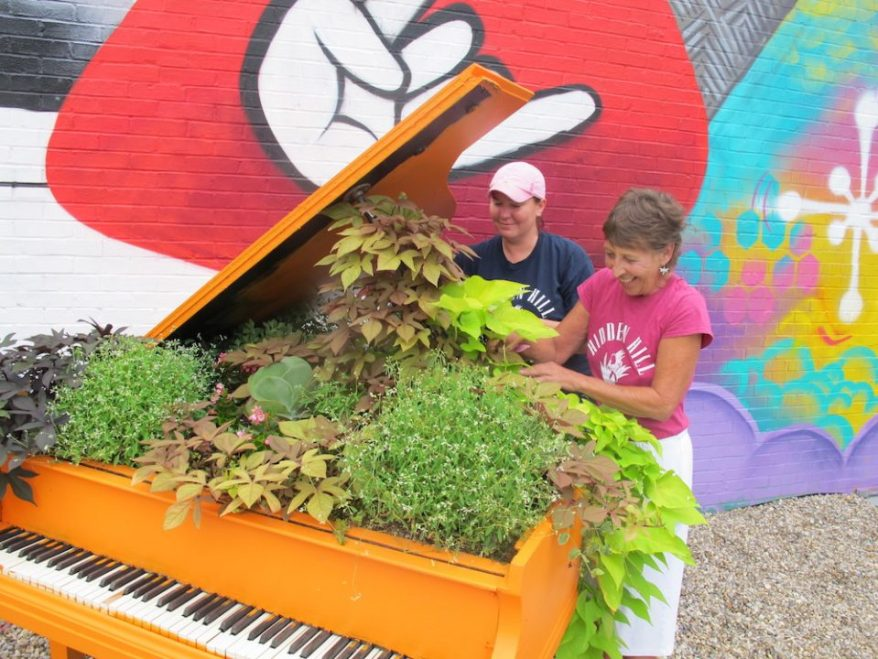 Cheryl Alvey and Dani Evans Landscaping a Piano