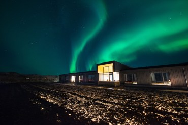 Northern Lights over Lilja Guesthouse | Hidden Iceland | Photo by Tom Archer