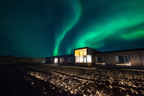 Northern Lights over Lilja Guesthouse | Hidden Iceland | Photo by Tom Archer | Feature