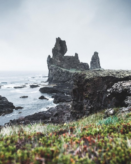Lóndrangar cliffs in the Snæfellsnes Peninsula | Snæfellsnes Peninsula Tour | Hidden Iceland | Photo by Norris Niman