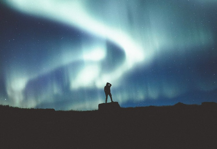 In awe of the Northern Lights photo by Norris Niman. Feature