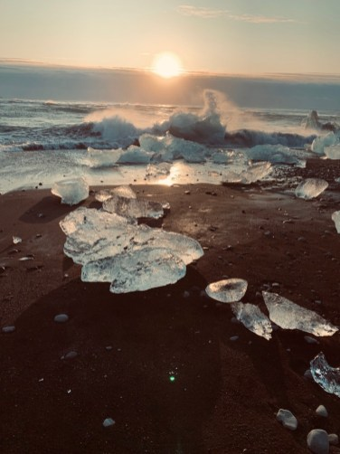 Remnant glacier ice washed up on 'Diamond Beach' by Jökulsárlón glacier lagoon at sunrise. Photo by Scott Drummond, Hidden Iceland