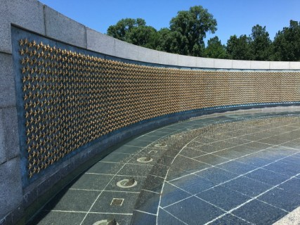 "World War II memorial. A wall of 4,048 gold stars reminds all of the price over 400,000 Americans paid to win that victory. ""Here we mark the price of freedom."""