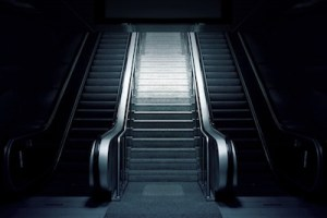 Black and white picture of an escalator