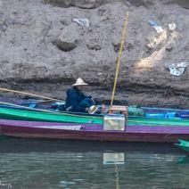 Fischer im Boot in Laos