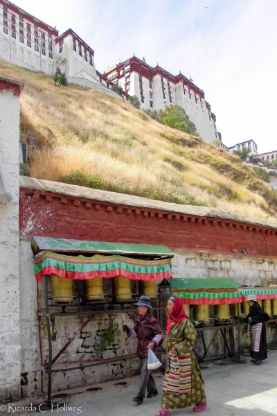 Prayer wheels below the Potala Palace
