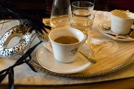 Coffee and a carnival mask at Cafe Florian Venice