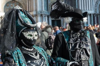 Green and black costumes at Venice Carnival