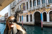 With carnival mask on the Grand Canal