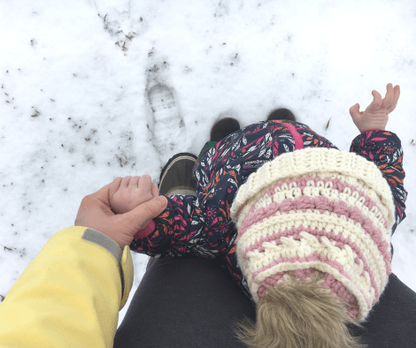 mom and daughter holding hands while wearing the dandelion beanie crochet pattern
