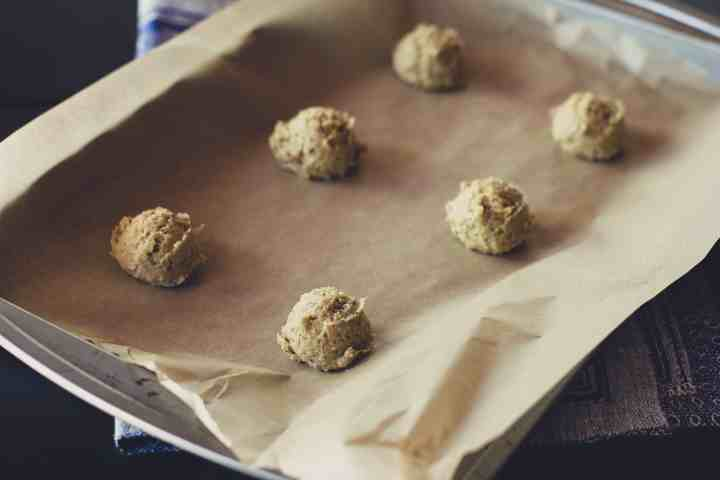 image of lemon poppy oat cookie dough balls ready to bake on a baking sheet