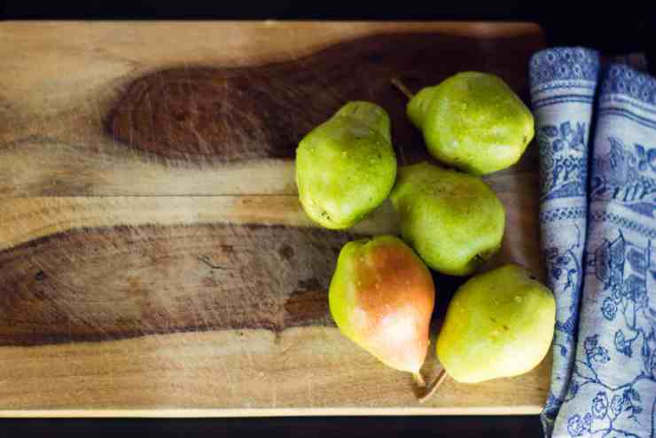 image of pears on cutting board for vegan pear almond crumble