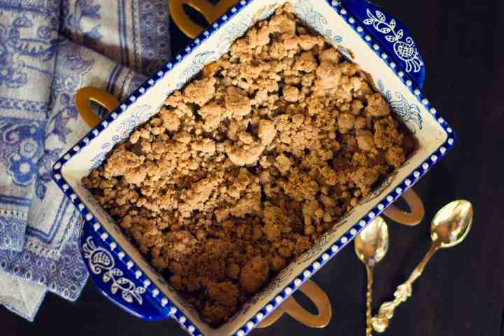 image of vegan pear almond crumble with spoons and kitchen towel