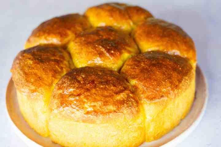 image of plated turmeric corn sourdough buns