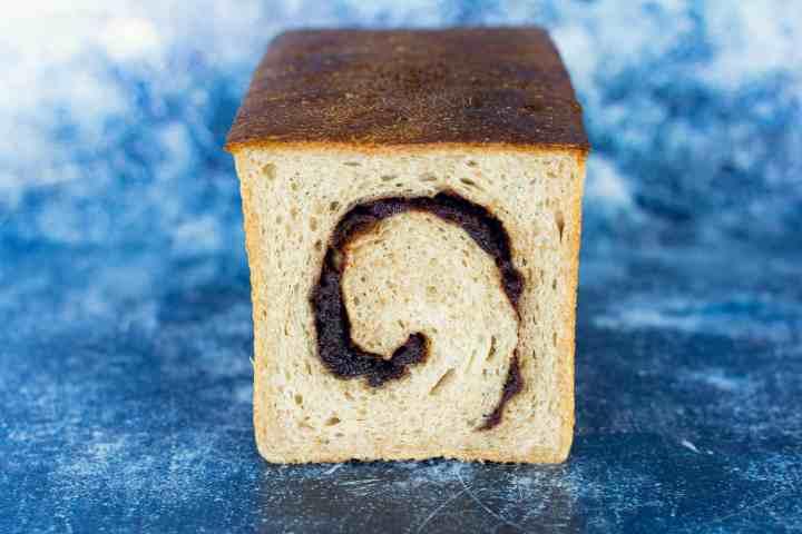 image of cinnamon jujube sourdough swirl bread sliced open
