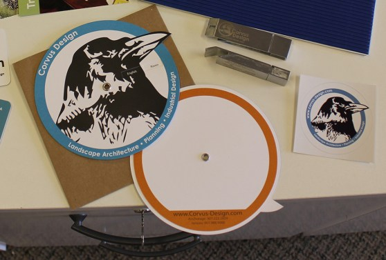Corvus Design Circular Raven Card, Bottle Opener USB Drive, and Logo Sticker