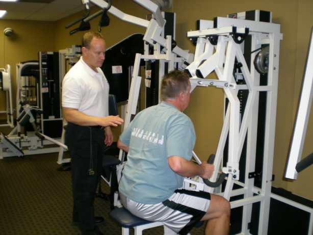 Tim Ryan at work with a client at Precision Fitness gym