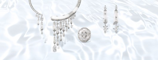 Lumières d'Eau Necklace in platinum, frosted rock crystal, diamonds and two pear-shaped diamonds; Lumières d'Eau ring, platinum, frosted rock crystal, diamonds and a cushion-cut diamond, and Lumières d'Eau earrings, platinum, white gold, frosted rock crystal, diamonds and four pear-shaped diamonds .
