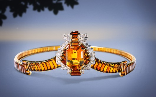 1937: Produced by Cartier London in 1937, this tiara is composed of yellow gold, platinum, old- and baguette-cut round diamonds, one large emerald-cut octagonal citrine of 62.35 carats as well as calibrated baguette-cut citrines and one hexagonal citrine. The central motif can be detached from the tiara and worn as a brooch, pointing downward.
