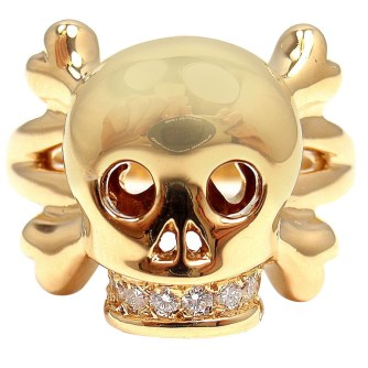 "18k yellow gold ""Tête de Mort"" diamond skull ring by Dior Fine Jewellery. Smooth skull and crossbones with diamond encrusted teeth, representing eternal love. Very rare. Found on 1stdibs."