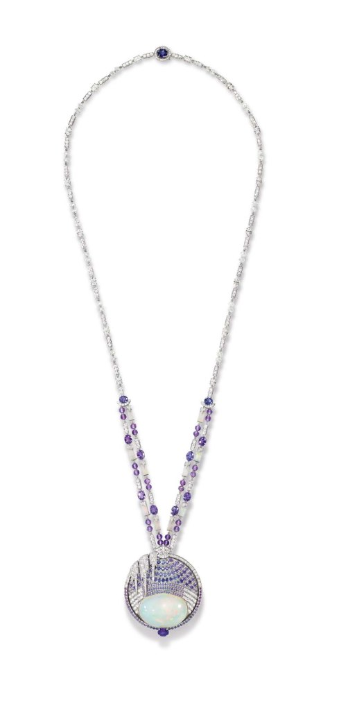 Chaumet's Lumieres d'Eau high jewellery necklace, created for the Biennale des Antiquaires in Paris, is set with a 59.58 ct cabochon-cut white opal and opal motifs from Ethiopia, round and oval-cut violet sapphires from Ceylon and Madagascar, oval-cut and brilliant-cut diamonds, and faceted diamond and amethyst beads.