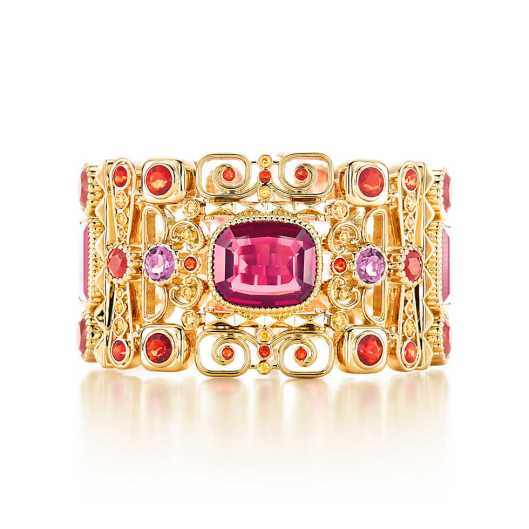 Designed from an archival sketch, this bracelet of yellow diamonds, fire opals, tourmalines and a center garnet glows in 18k gold. Carat weight: cushion-cut garnet, 12.30. Carat total weight: emerald-cut pink tourmalines, 20.63; fire opals, 12.63; yellow diamonds, 5.12.