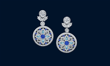 18 round brilliant sapphires weighing a total of approximately 0.84 carats, 8 pear-shaped aquamarines weighing a total of approximately 0.45 carats, and 438 marquise, pear-shaped and round brilliant diamonds weighing a total of approximately 7.43 carats, set in platinum.