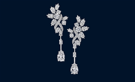 56 marquise, pear-shaped and round brilliant diamonds weighing a total of approximately 10.18 carats, set in platinum.