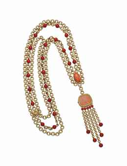 A CORAL AND GOLD PENDENT WATCH, BY PIAGET  The coral dial within a gold ropework bezel, bearing gold hands, on a triple gold link chain, highlighted by coral beads and detail to the gold and coral bead fringe, 1970s. Estimate US$ 12,550 - $18,825.