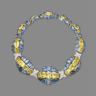 A SAPPHIRE, COLOURED SAPPHIRE AND DIAMOND NECKLACE, BY DAVID WEBB  Composed of ten graduated oval-shaped bombé links, each centering upon a cushion-shaped yellow sapphire line, between vari-cut sapphire lines with pavé-set diamond cross-shaped links at the front, mounted in platinum and gold, 1958. Estimate US$ 250,995 - $298,056.
