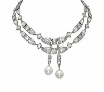 Of Indian inspiration, composed of two rows of pear-shaped and old-cut diamond links, suspending at the front two natural pearl pendants, measuring approximately 16.0 x 15.9 mm and 16.3 x 15.8 mm, with four additional links, mounted in platinum, 33.0 cm