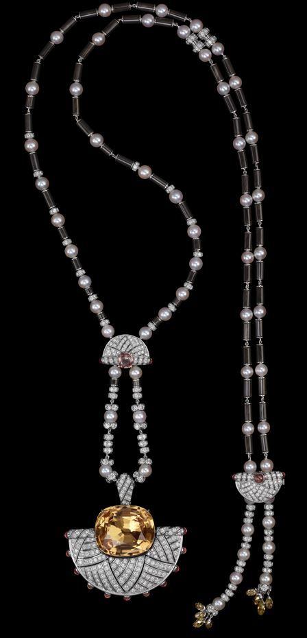Cartier. Platinum, one 40.45-carat cushion-shaped golden topaze, cabochon-cut, briolette-cut and cushion-shaped orange sapphires, cultured pearls, obsidian, onyx, brilliants.