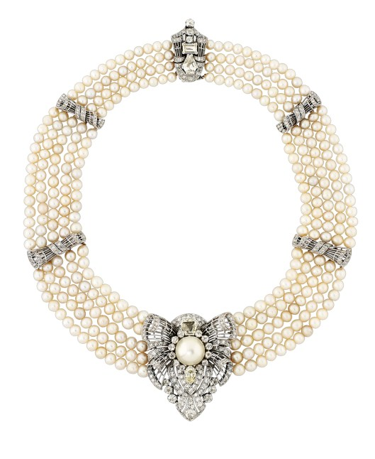 AN ART DECO NATURAL PEARL AND DIAMOND NECKLACE/CLIP BROOCH Of collar design, composed of four and then five rows of 56, 62, 70, 76 and 56 graduated natural pearls measuring approximately 6.1-4.7mm, interspersed with diamond-set openwork bow design spacer panels, suspending a central diamond-set shield shaped pendant / clip brooch, with a central natural pearl highlight measuring approximately 14mm, to an old-cut diamond cluster surround with adjacent fancy and marquise-cut diamond accents, the clasp similarly-set, circa 1930, minimum length 38.1cm.